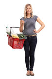 Young woman carrying a shopping basket Stock Photo