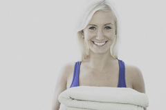 Young woman carrying towels Stock Photos