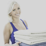 Young woman carrying towels Stock Photo