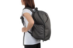 Young woman carrying with travel backpack isolated white backgro Royalty Free Stock Images