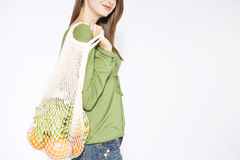 A Young Woman Carrying Vegetables In A Shopping Bag Stock Photos