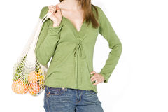 A Young Woman Carrying Vegetables In A Shopping Bag Stock Photo