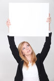 Young woman carrying white panel Stock Photo