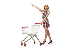 Young woman with cart isolated on white Stock Photos