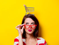 Young woman with cart Royalty Free Stock Photography