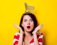Young woman with cart Royalty Free Stock Photo