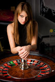 Young woman in casino Royalty Free Stock Image