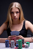 Young woman in casino with cards and chips Stock Photos