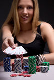 Young woman in casino with four aces in hand Stock Photography