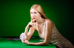 The young woman in casino gambling concept Stock Photo