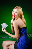 The young woman in casino gambling concept Stock Images