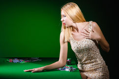 The young woman in casino gambling concept Royalty Free Stock Photo