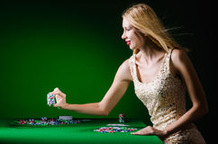 The young woman in casino gambling concept Stock Photography