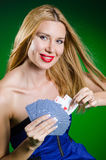 The young woman in casino gambling concept Stock Image
