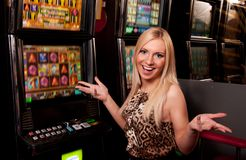 Young woman in Casino on a slot machine. Woman in Casino on a slot machine Royalty Free Stock Photos
