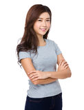 Young woman in casual attire looking and smiling Stock Photos