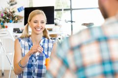 Young woman in office having fun Stock Photo