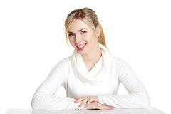 Young woman in casual clothes sitting at the desk Royalty Free Stock Images