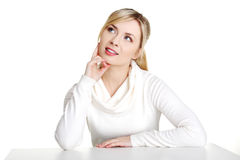 Young woman in casual clothes sitting at the desk Royalty Free Stock Image