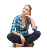 Young woman in casual clothes sitting on floor Stock Photos