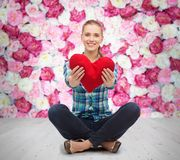 Young woman in casual clothes sitting on floor Royalty Free Stock Images