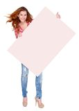Young woman in casual clothing holding empty board Royalty Free Stock Images