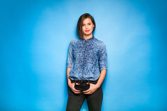 Young woman casual dressed on blue background Royalty Free Stock Images