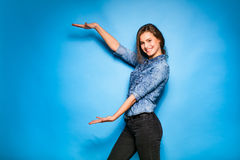 Young woman casual dressed on blue background Stock Images