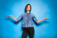 Young woman casual dressed on blue background Royalty Free Stock Photo