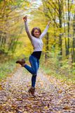 Young woman dancing in the forest Royalty Free Stock Photos