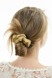 Young woman with casual messy bun hairdo Royalty Free Stock Photo