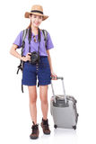 Young woman in casual walking with the travel bag with a camera Royalty Free Stock Photo