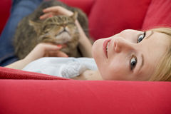 Young woman with cat Royalty Free Stock Photos
