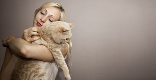 Young Woman with Cat Royalty Free Stock Photography