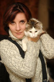 Young woman with a cat Stock Image