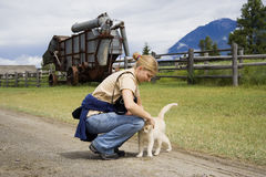 Young woman with a cat. In a rural scenery - adobe RGB Royalty Free Stock Photo