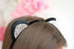 Young woman in cat ears on blurred background. Closeup Royalty Free Stock Images