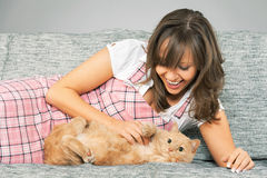 Young woman with cat Stock Images