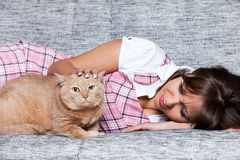 Young woman with cat Stock Photos