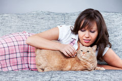 Young woman with cat Stock Photo