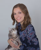 Young woman with a cat, studio photo Stock Images