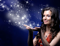 Young woman catches Star. Rain by hands stock images