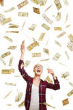 Young woman catching flying dollar bills Stock Images