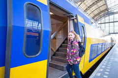 Young woman catching the train in Amsterdam central station Netherlands Royalty Free Stock Images