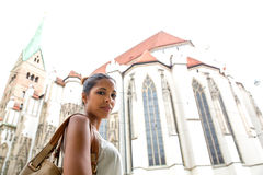 Young woman at the cathedral Stock Images