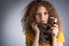 Woman caught a cold, her throat inflamed. A young woman caught a cold, her throat inflamed, cough, splashes with a medicine throat Stock Photography