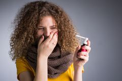 Woman caught a cold, her throat inflamed. A young woman caught a cold, her throat inflamed, cough, splashes with a medicine throat Royalty Free Stock Photography