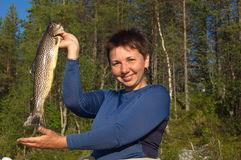 Young woman caught her first brown trout. stock photos