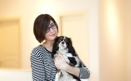 Young woman with dog Royalty Free Stock Photography