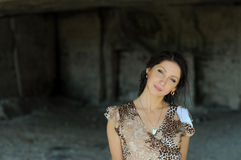 Young woman in a cave Royalty Free Stock Photography